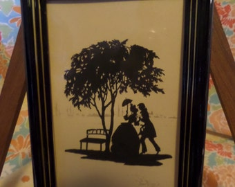 Framed Silhouette of courting couple under tree