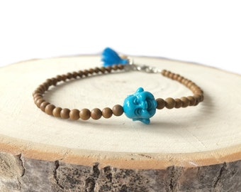Boho style anklet with 4mm brown glass beads, denim blue buddha head, denim blue tassel and a shell charm