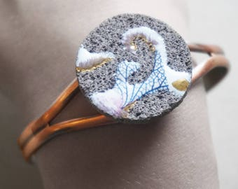 Unique and adjustable bracelet in lava glazed organic unstructured leaf ribs and touches of gold.