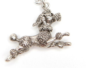 leaping poodle necklace