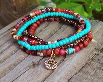 Flower charmed bracelet stack - Colorful Beaded Stretch Bracelets with Bohemian Flower Charm - Bracelet Stack