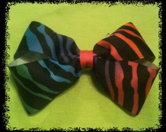 Multi Color Zebra Boutique Bow. Hot Pink Center.