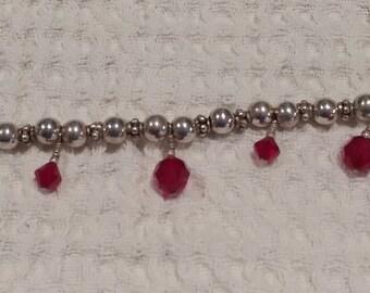 Vintage Sterling silver 7-inch bead bracelet with red Swarovski crystals