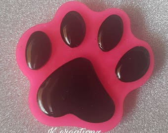 Pink and black paw print magnet