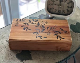 Custom, hand made wood box; old reclaimed pine wood, ivy wood burned lid, fabric lined, hand rubbed oil finish.