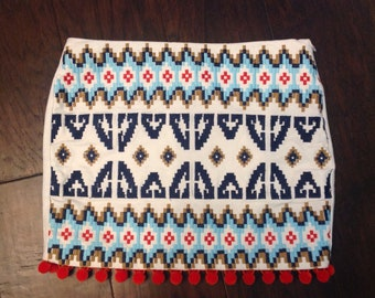 Embroidered aztec skirt with orange pompons
