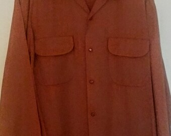 vintage 1940s-1950s rust colored gabardine shirt with flap pockets
