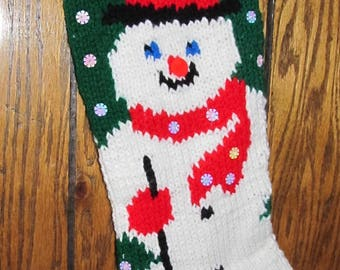 Hand-Knitted Snowman Christmas Stocking with Green Background and Sequin Snowflakes