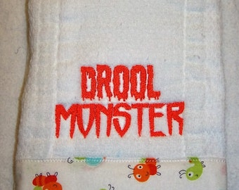 Diaper burp cloth for baby/infant embroidered with Drool Monster.