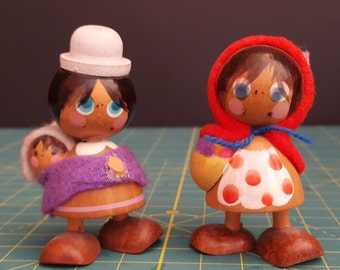 Two, handmade, wooden, doll figures from Peru.