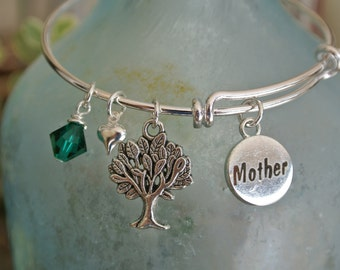 Adjustable silver bangle bracelet with a tree of life charm, Mother charm, birthstone and heart.