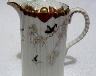 A Japanese Ribbed Porcelain Hot Water Jug