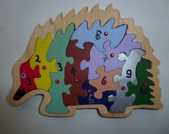 Handmade puzzle of solid wood , numbers