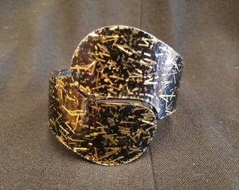 Mid Century Black and Gold Confetti Lucite Hinged Bracelet, ca 1950s