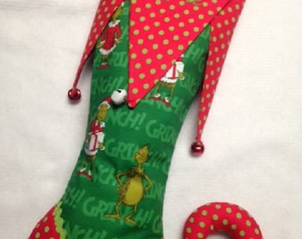 Green and red elf toe Christmas stocking with bells