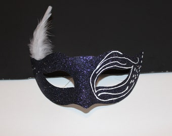 Black mask with white feathers and swirls