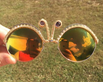 Rays of sunshine wire wrapped amethyst round frame sunglasses