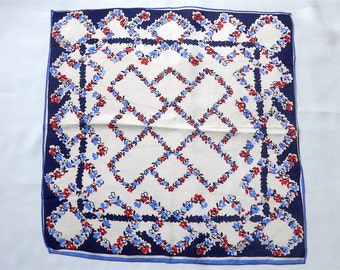 Handkerchief, vintage.   It has a linear floral design in shades of blues and red, silk, a pretty hanky.   c 1930's.