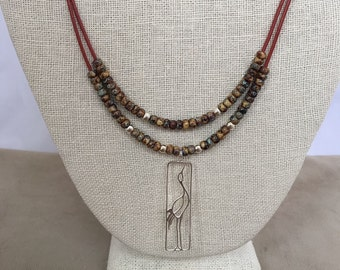 Crane pendant leather necklace with sterling silver pendant, beads, and clasp