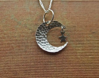 Sterling silver crescent pendant with star