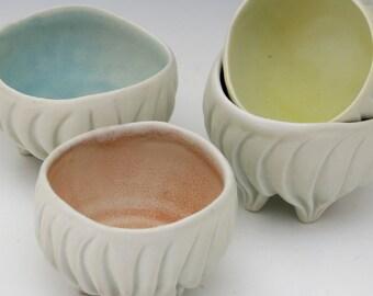 Pastel ring bowl, white & yellow, pinkish peach, carved porcelain, trinket bowl