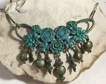 Antiqued patina on brass focal piece with brass chain necklace