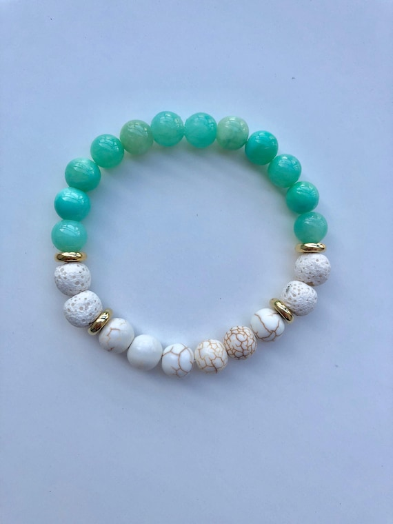 Essential oil diffuser bracelet with green glass beads and white lava beads