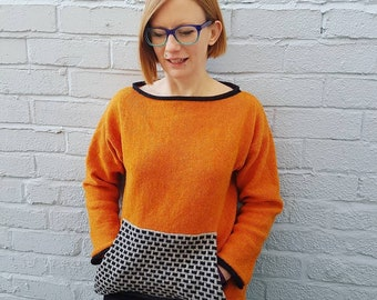 Boat Neck/Off the Shoulder Pocket Sweater knitted in Cozy Shetland Wool orange with black trim and grey & black pocket- sustainable knitwear