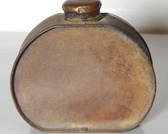 Vintage tinware oval bottle