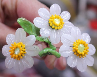 Sweet daisy flowers on copper wire