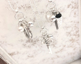 Long Sterling Silver Multi Charm Tassel Necklace . Heart . Wing . Key . Fether . Swarovski . Tassel by Brag About It