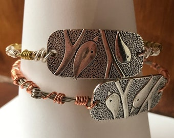 Guitar string bracelet bangle, recycled guitar string with bird motif charm. Strings gone wild