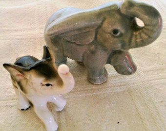 A Pair of Vintage Porcelain Elephants One Gray And one Black And White