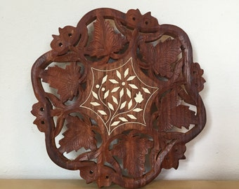 Wood hand carved trivet. Made in India.