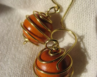 Fancy beads in orange and gold wood cage earrings