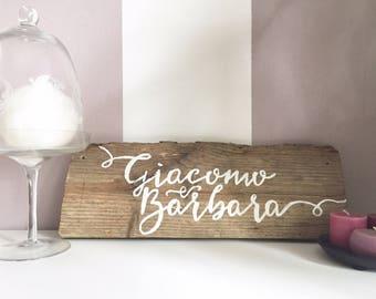 Custom calligraphic antique wood sign