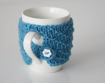 Cute cup with warm sweater