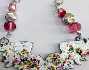 Enamel winged heart necklace on a silver chain