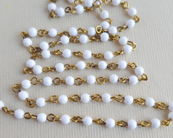 Vintage white lucite and brass rosary bead chain