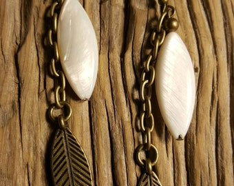 Drop earrings with Mother of Pearl and feather dangles.