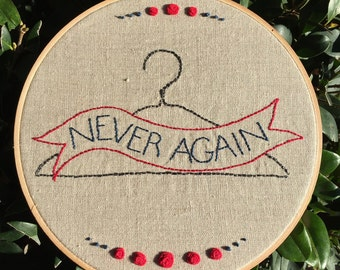 Never Again, hooped embroidery on linen, proceeds from sale will go to Planned Parenthood