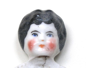1800s Antique china doll head with  black hair. German Frozen Charlotte, white porcelain.