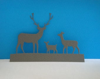 Cutting landscape 3 gray deer paper for scrapbooking and card design