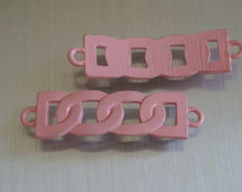 Slightly curved connector curbed soldered metal flesh, 42 x 11 mm, tinted, two round holes: 2.5