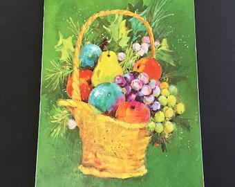 Vintage mid century Christmas greeting card, gold basket, colorful fruit