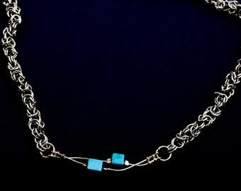braided alpaca necklace with turqu0isestones, length 49cm.