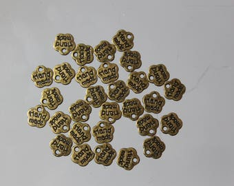 100 hand made brass flower charms engraved.