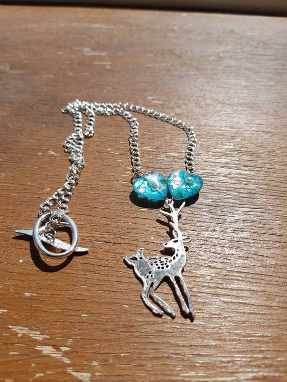 Reindeer necklace with blue hearts