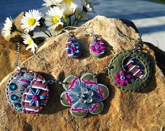Pink, blue and gray flowers set made of polymer clay.