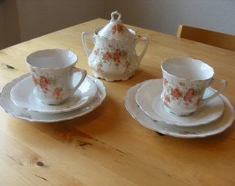 Victorian tea cups ,saucers, dessert plates and sugar bowl with orange flowers